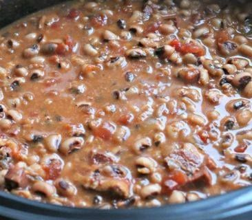 BLACK EYED PEAS WITH HOG JOWL  1 chopped onion, sauteed in bacon grease 1 lb. black-eyed peas 1/2 lb. hog jowl 1 can diced tomatoes with or without green chiles (optional) Salt & Pepper to taste  Boil hog jowl in 2 quarts water for 1 hour. Add onion and peas that have soaked overnight and if using, the diced tomatoes. Simmer about 45 minutes or till tender. Season with salt & Pepper.