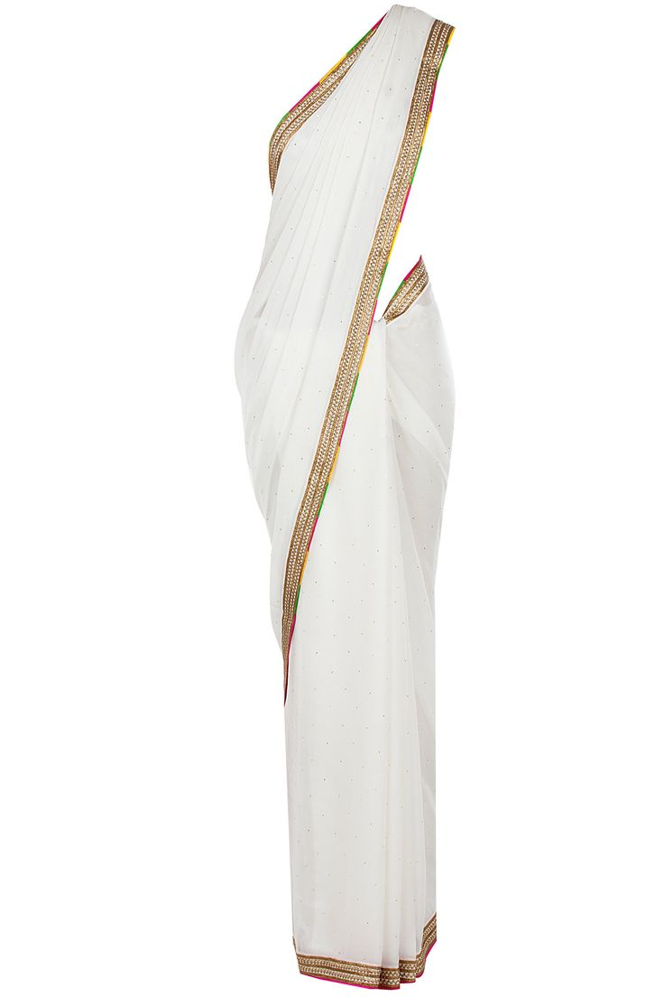 Ivory sari with embroidered blouse available only at Pernia's Pop-Up Shop.