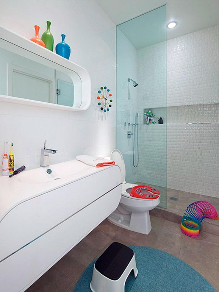 A White Contemporary Bathroom Is Easy To Dress Up With Fun, Colorful  Accessories For Younger