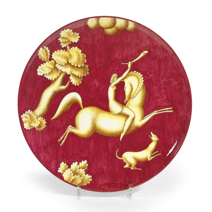 GIO PONTI (1891 - 1979) FOR RICHARD GINORI L'AMAZZONE CON IL CORNO': A LARGE DISH earthenware, the red ground painted with a huntress astride a horse, a dog at her feet black painted mark, 'Richard Ginori, M.229?368E, Gio Ponti' 35.5cm.; 14in. circa 1928