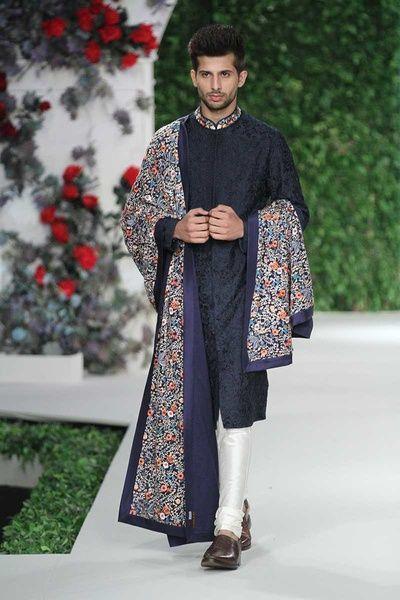 Groom Wear - Black Sherwani with White Churidar and an Embroidered Multi-colored Safa | WedMeGood #wedmegood #indianwedding #indiangroom #groomwear #sherwani #varunbahl