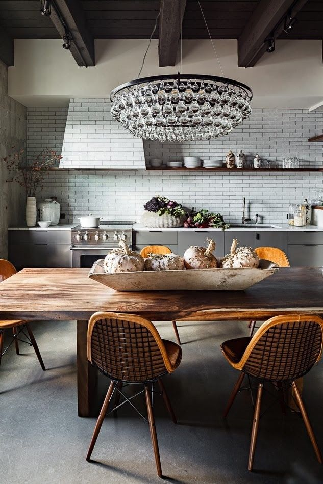 Ochre Arctic Pear Chandelier over wood dining table in rustic kitchen, white subway tile, Jessica Helgerson Kitchen | Remodelista