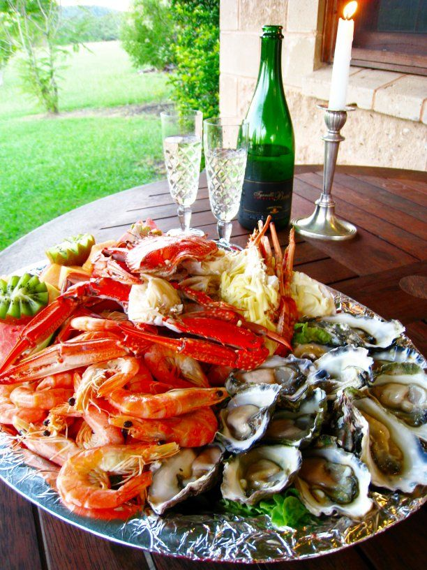 seafood platter and a glass of wine | indulgent taste | fine dining | oysters