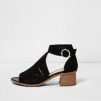 Faux suede fabric upper Laser cut detail Cut out sides Flared stacked block heel Open toe Buckle fastening