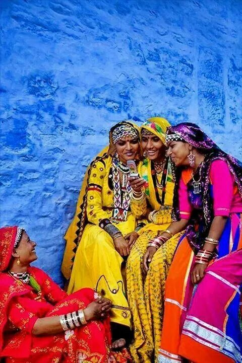 Colorful Indian ladies chatting on a cell phone. (V)