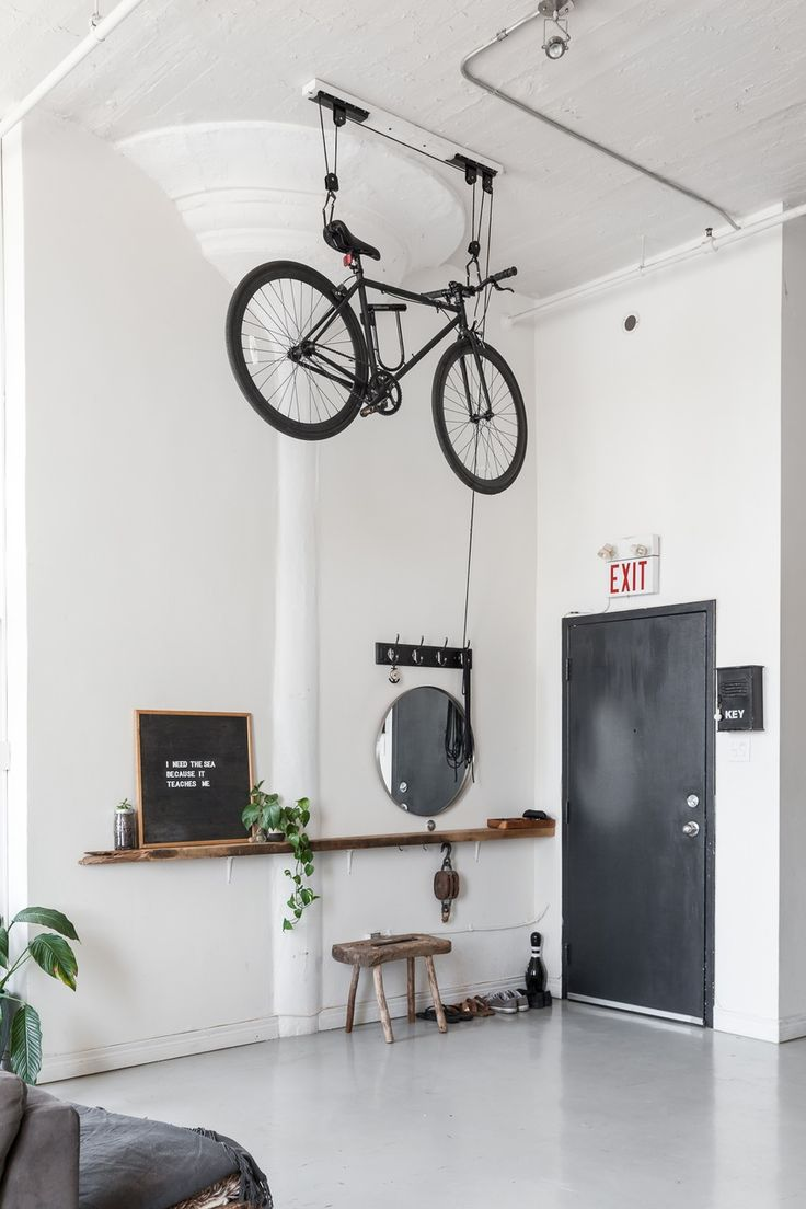 This Toronto apartment's super high ceilings work perfectly for this one-of-a-king bike pulley system. In a small space or large, keeping your bike out of the way and secure can be a huge challenge - if you have the ceiling space why not bill it with a bicycle!