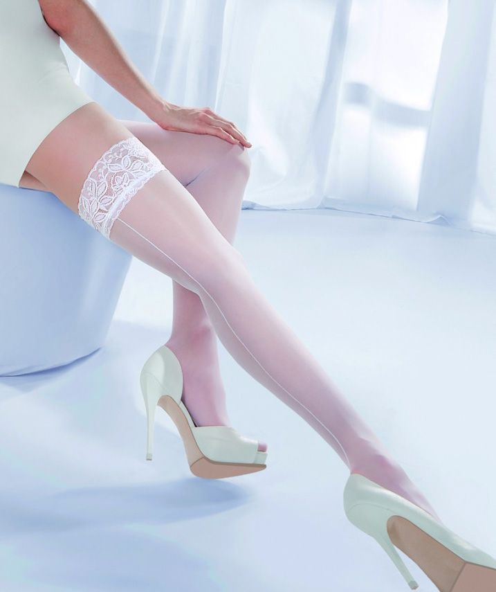 Gabriella Princessa Calze 05 Hold Up Stockings £14.50  Classic white hold up stockings with wide embroidered band and seam running down the legs. Ideal for bridal wear. #gabriella #stockings