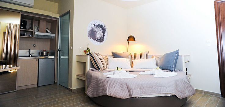 Studio 4 is on the first floor and is the same design as Studio 3 but will cool muted colours and an invigorating black and white tiled bathroom! Once again there is a round double bed and single chair bed, wardrobes, dressing table and a kitchenette. The elevated balcony gives you the most amazing views.