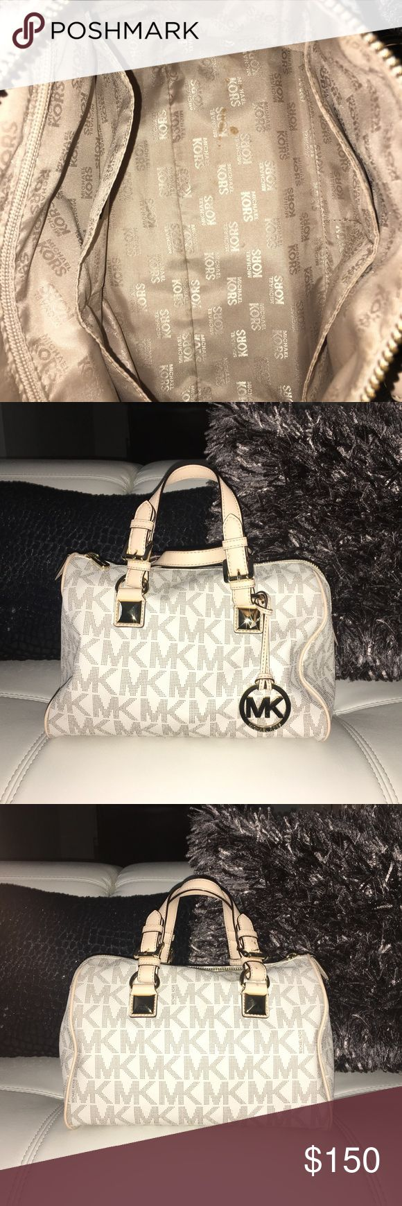 Michael Kors Grayson Small Satchel- Vanilla This is a gently used purse that I've had for 3 years now. I bought it at a retail price around $300 at the Michael Kors store located in Albertville, Minnesota. I am selling it for $180 because small purses no longer interest me! If you need any further assistance, please feel free to let me know. Thank you. *****DISCLAIMER***** THERE IS A SMALL WHITE CHOCOLATE STAIN INSIDE OF THE BAG THAT I WILL CLEAN BEFORE SHIPPING OUT!!! Michael Kors Bags…