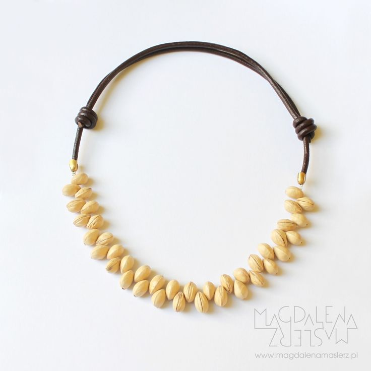 magdalena maślerz - a necklace: brown leather strap and seeds of cherries. 2011