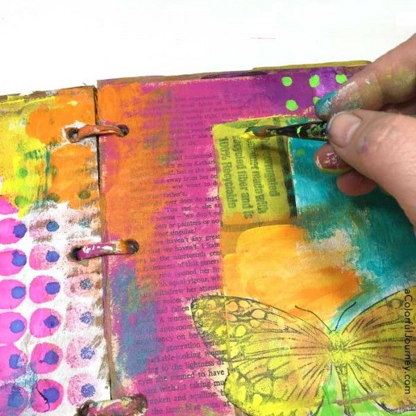 Video tutorial adding layers of color in a cardboard art journal with Carolyn Dube
