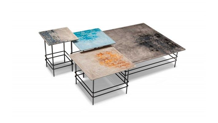 """Coffee tables: top in wood and stucco. They are handmade decorated according to the Apulian artcraft tradition; the top is protected with a transparent synthetic resin. The structure is varnished and composed of a raw iron base It represents a unique combination of natural and recycled materials, a project with an evocative value where art and craftwork are linked thanks to the traditional craftsmen's and designer's work reflecting the experience of the """"made in italy""""."""