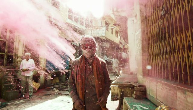 Experiencing the festival of Holi, in all of it's magical and polychromaticglory. To celebrate the beginning of spring, Hindus of all ages and statuses throughout India light bonfires and joyously throwscented powder and perfume at each other.