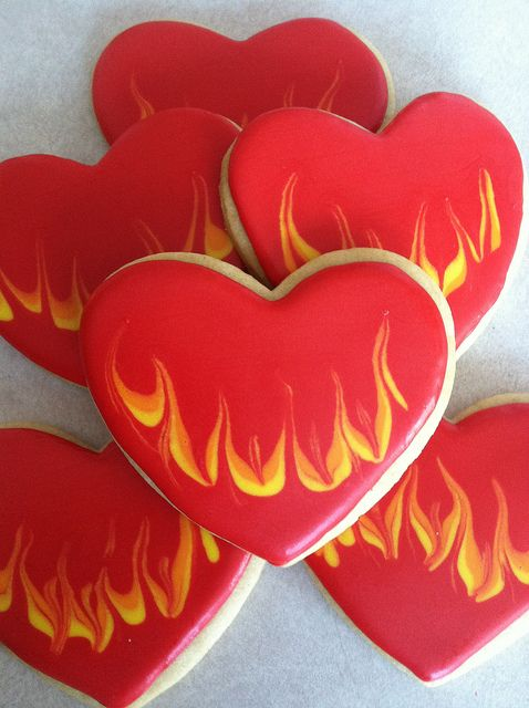 """Flaming hearts by Sugar Beez:  These are simple, but my all-time favorite cookie design so far.  Every time I look  at these cookies I just glow knowing I did them!"""