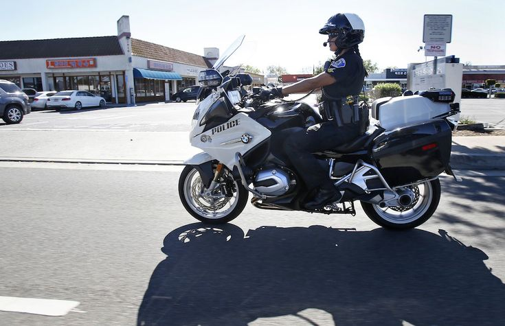 Garden Grove Police Department motorcycle officer Katherine Anderson patrols the city's streets on her BMW bike. Photo by Christine Cotter