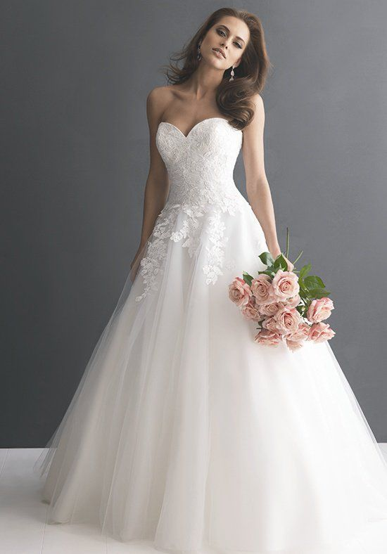 This romantic ball gown is created from soft, lace applique and English net. The strapless, sweetheart bodice is adorned with lace with a fitted dropped waistline. Lace continues to cascade onto the full, ball gown skirt.
