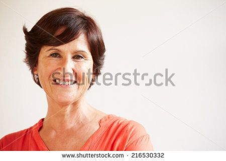Portrait Of Middle Aged Woman Standing By Wall