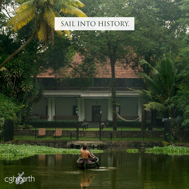 A countryboat rows towards a former palace in Kerala.