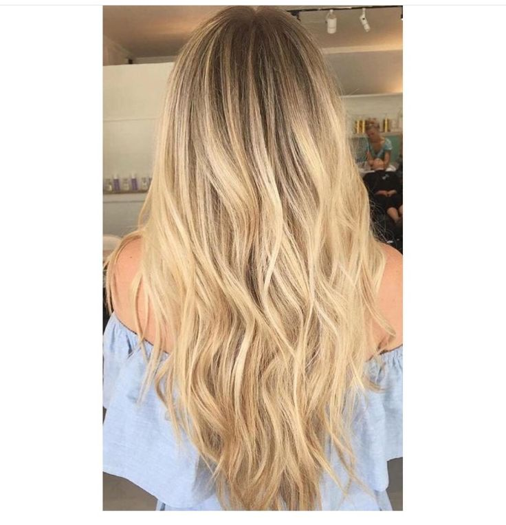 Warm butter blonde with shadow root