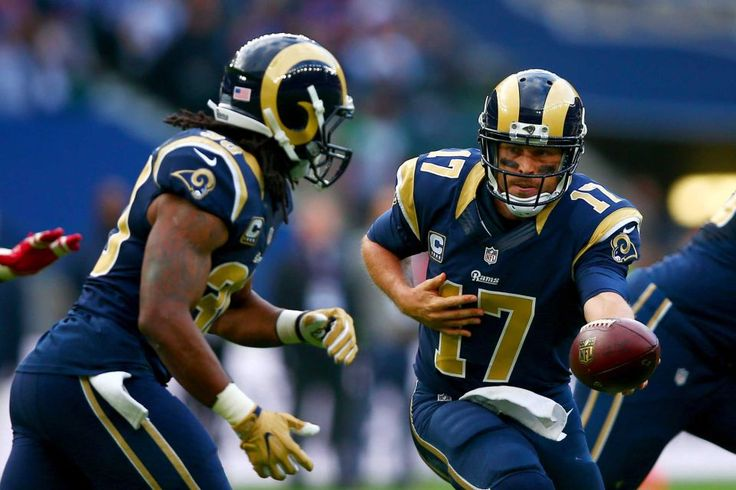 Giants vs. Rams in London:     October 23, 2016  -   17-10, Giants  -  Case Keenum #17 of the Los Angeles Rams hands off to Todd Gurley #30 of the Los Angeles Rams during an NFL game between the New York Giants and the Los Angeles Rams at Twickenham Stadium in London, Sunday Oct. 23, 2016.