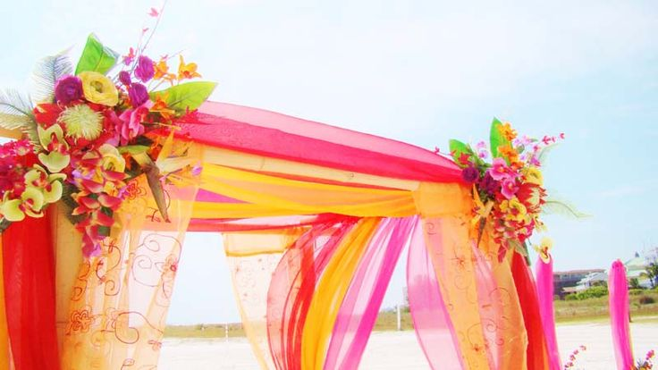 #Tropical arch #Tropical canopy  #Tropical Beach Wedding  Could use plastic table clothes for a similar effect for a bday party