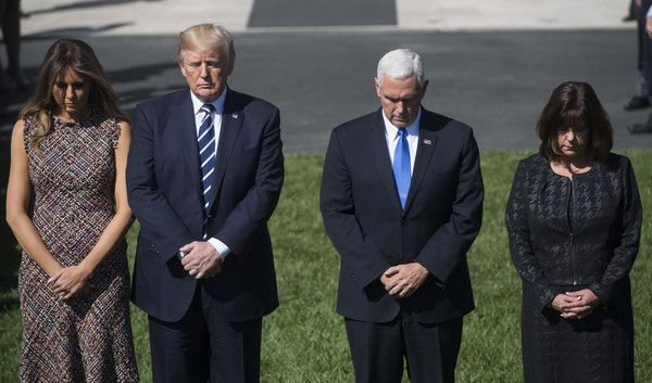 Donald Trump Photos - US President Donald Trump and First Lady Melania Trump along with Vice President Mike Pence and his wife Karen Pence take part in a moment of silence for the victims of the Las Vegas shootings, on the South Lawn of the White House on October 2, 2017 in Washington, DC. / AFP PHOTO / SAUL LOEB - President Trump and First Lady Melania Trump Hold Moment of Silence for Victims of Las Vegas Shooting