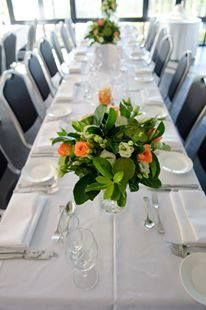 Table Flowers. Orange and green. Lotus Pods