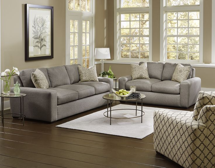 Relax in style with this clean lined sofa set from england for Cleaning living room furniture
