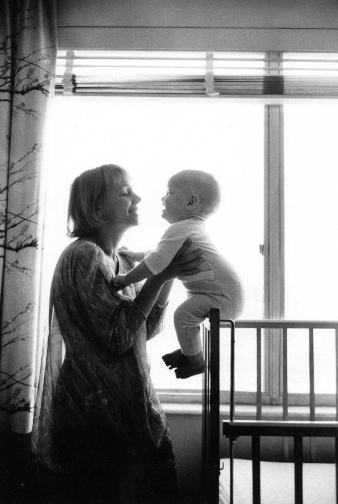 Long-Lost Photos Show What Hasn't Changed About Motherhood In 50 Years