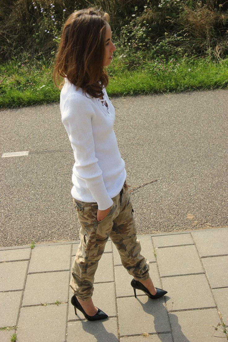 love camouflage pants with a pair of black sleek heels. they guarantee a simple, easy, and rocking cool outfit.
