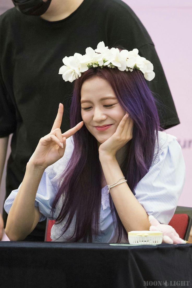jisoo black pink with flowers in the head