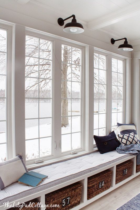 Lake house sun room window seat decorated in classic blue and white including ticking fabric. Space decor by @krinze