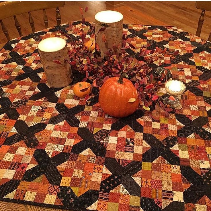 We love seeing #apqquiltalong quilts used in holiday decorating! This beauty from @quiltedmoose is perfect for a fall table! (Original pattern by @amrosenthal in the April 2015 issue of #americanpatchworkandquilting.)