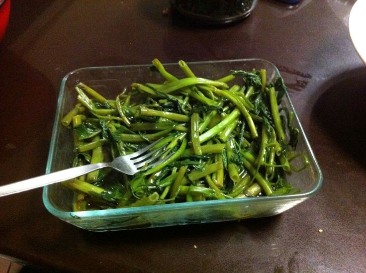 Eat your greens Malaysian style: Kang Kung vegetables stir-fried in Belachan. Smelly but oh so tasty!