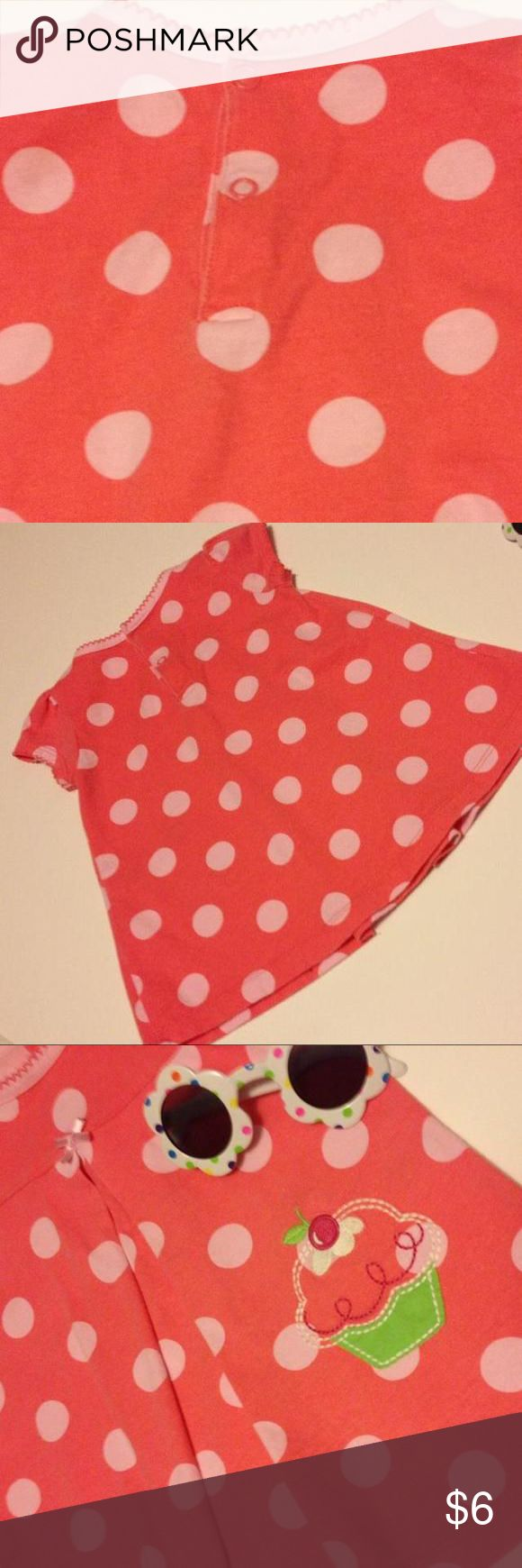 Child of Mine--Carter's -- 6-9 Months Child of Mine--Carter's -- 6-9 Months Pinkish-peach in color with white polka dots and appliqué cup cake. Such a cute little dress that looks darling on. 100% cotton making for a nice cool dress on those hot summer days. Dress is very soft to the touch! Carters Dresses