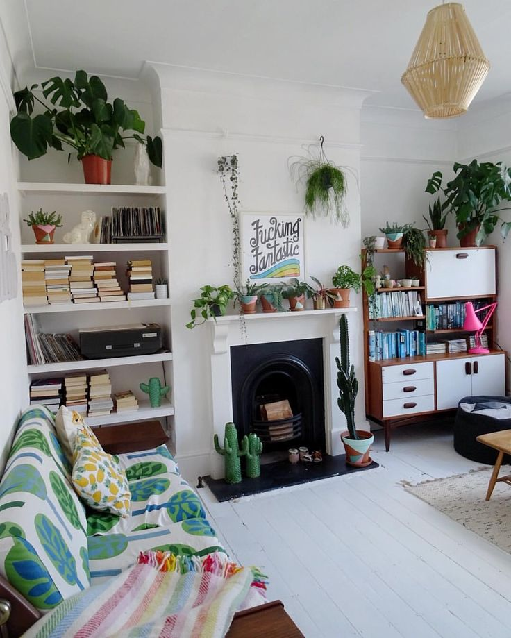 Plant filled boho living room with painted white for White boho living room