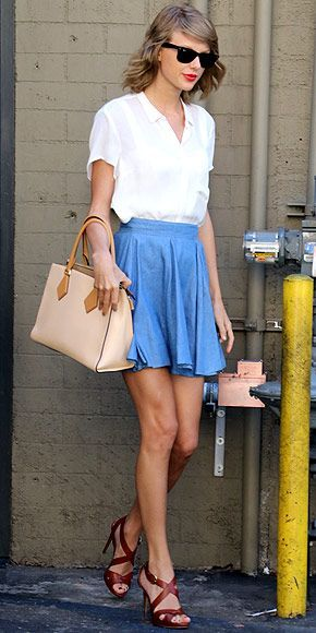 Taylor Swift street style: Her white Aritzia blouse, blue mini skirt, and…