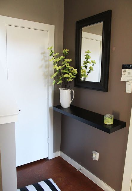If you have a small entry way in your house or condo, give it a purpose by hanging a mirror & a floating shelf.  Now you have a place to put down your keys when you walk in.