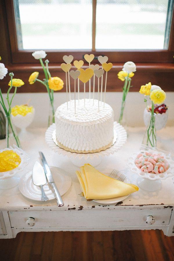 heart cake topper http://www.weddingchicks.com/2013/09/17/wedding-in-white-and-yellow/