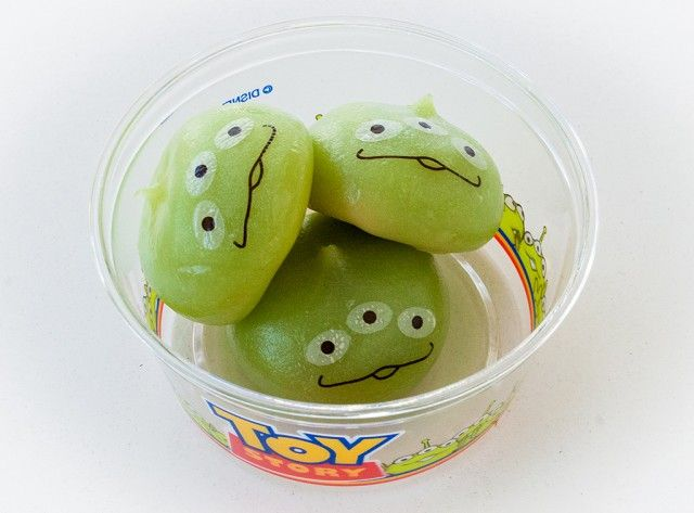 Cool mochi Toy Story Alien snacks from Tokyo Disneyland. Check out all the crazy snacks from Tokyo Disney in this article!