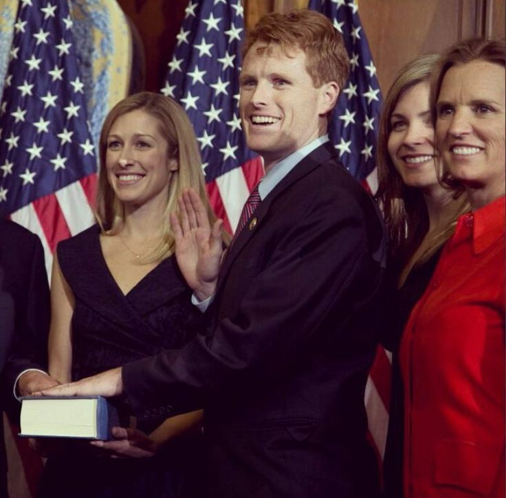 Joseph P Kennedy III being sworn in as Congressman from the 4th District of Massachusetts, with wife Lauren Birchfield Kennedy (left) and his aunt, Kerry Kennedy (in red)