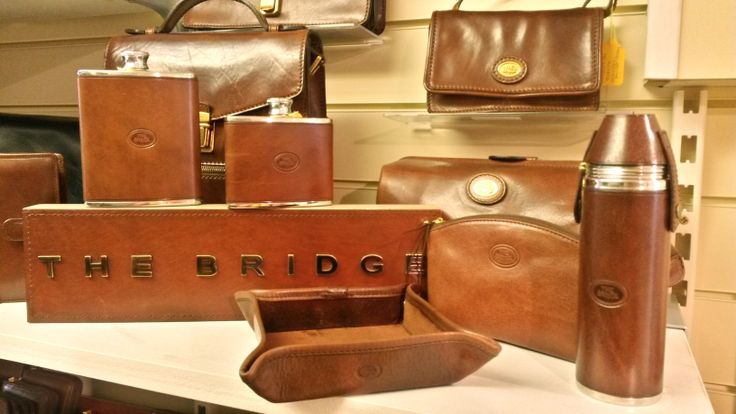Classic leather goods from The Bridge, available in-store or online from Luck of Louth. We love our gorgeous Italian leather goods from The Bridge. Treat your Dad to a gift that will never go out of style and will look better the more it's used. With change trays, wash bags, hip flasks, phone covers, document holders and man bags - there's so much to choose from.