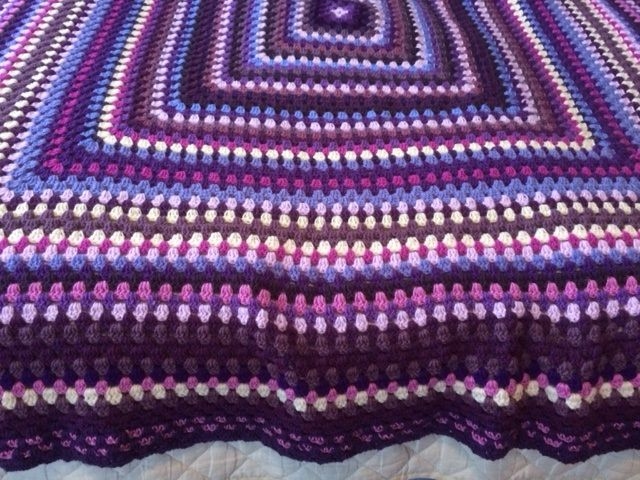 Bright Crocus Blanket in purples. New edging I may have to develop as it looks like tiny hearts!