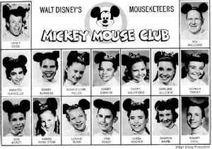 The Mickey Mouse Club. My mom took a picture of me sitting in front of this tiny TV with my Mouseketeer Hat on.