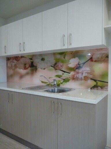 Like the idea of using a wallpaper with a clear glass splash back that can be updated in the future.