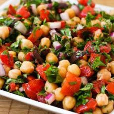 Chickpea Salad with Tomatoes, Olives, Basil, and Parsley