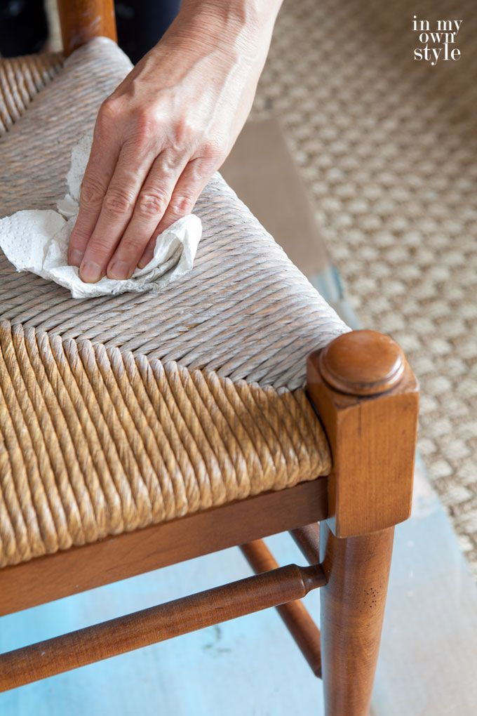 Wiping-off-stain-on-dining-room-rush-seat-chair