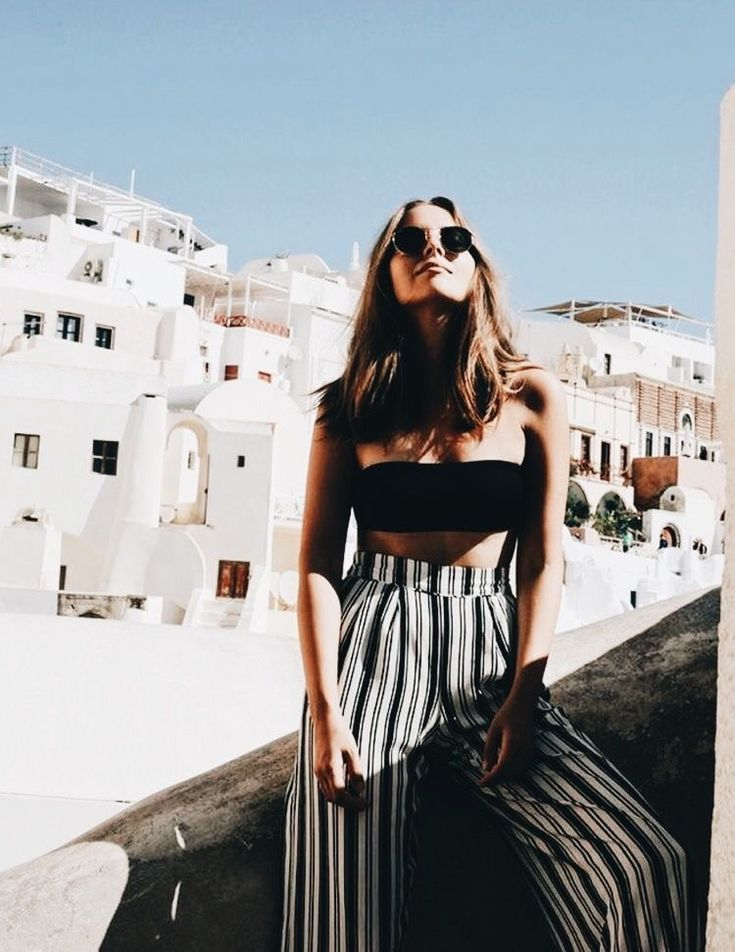 Cute high waisted black and white striped pants with little black tube top.