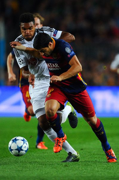 Luis Suarez of FC Barcelona competes for the ball with Jonathan Tah of Bayer 04 Leverkusen during the UEFA Champions League Group E match between FC Barcelona and Bayer 04 Leverkusen on September 29, 2015 in Barcelona, Catalonia.