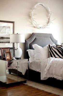 belgrave headboard + mirrored side table + white linen + zebra print + interesting accessories